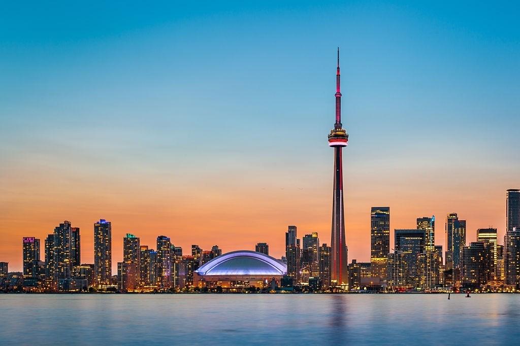 Skyline of Toronto over Ontario Lake at twilight